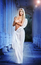 Blonde angel with white light wings and white veil posing outdoor Royalty Free Stock Photos