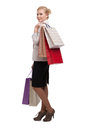 Blonde attractive business woman in a light beige suit holding shopping bags Stock Image