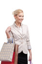 Blonde attractive businesswoman in a light beige suit holding shopping bags Royalty Free Stock Image