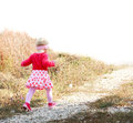 Blonde baby girl is running Royalty Free Stock Photography