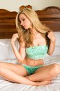 Blonde beautiful tall in seafoam green lingerie Stock Photo