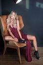 Blonde beautiful woman wearing fashionable dress. Royalty Free Stock Photo