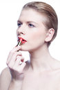 Blonde beauty applying lipstick isolated on white Royalty Free Stock Photo