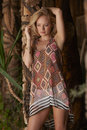 Blonde beauty rustic garden beautiful blond model posing in tropical on sunny day Royalty Free Stock Image
