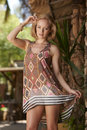 Blonde beauty rustic garden beautiful blond model posing in tropical on sunny day Royalty Free Stock Photos