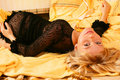 Blonde on bed Royalty Free Stock Image