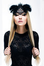 Portrait of Stylized Woman Blonde in Black Carnival Mask with Feathers. Holiday Royalty Free Stock Photo