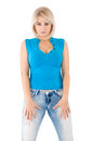 Blonde in a blue blouse and jeans Stock Photos