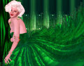 Blonde bombshell in green evening gown against matching green abstract background. Royalty Free Stock Photo