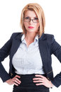 Blonde and bossy business woman with hands on her hips Royalty Free Stock Images