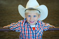 Blonde boy blue eyes cowboy hat Royalty Free Stock Images