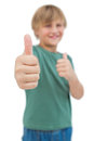 Blonde boy giving thumbs up focus shot on white background Stock Images