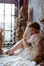 Blonde bride in fashion white wedding dress with makeup Royalty Free Stock Photo