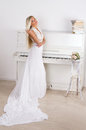 Blonde bride near the piano Royalty Free Stock Images