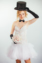 Blonde bride in tophat with veil and long black gloves