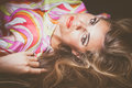 Blonde brown eyes young woman beauty portrait lie down closeup Royalty Free Stock Photo