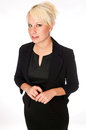 Blonde business woman in a black suit caucasian looking toward the camera with confidence Royalty Free Stock Photo