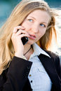Blonde business woman on mobile phone Stock Image