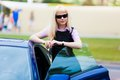 Blonde business woman next car portrait beautiful Royalty Free Stock Photography