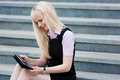 Blonde business woman with tablet portrait beautiful Royalty Free Stock Image