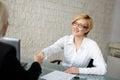 Blonde businesswoman in glasses handshake Royalty Free Stock Photo