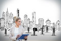 Blonde businesswoman using tablet pc with cityscape digital composite of Royalty Free Stock Images
