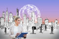 Blonde businesswoman using tablet pc with cityscape digital composite of Stock Images