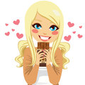 Blonde chocolate lover beautiful girl holding bar with love and happiness Stock Photos