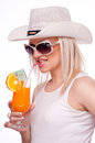 Blonde drinking orange juice Stock Photography