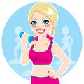 Blonde with dumbbell active practicing fitness exercise at the gym Stock Photo