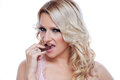 Blonde eating candy Stock Images