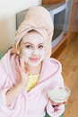 Blonde with face pack relaxing on sofa indoors Royalty Free Stock Photo