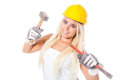 Blonde female builder sexy young girl working as a building labor with protection helmet hammer and gouge or chisel Royalty Free Stock Photo