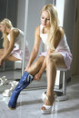 Blonde fits on a modern blue boots Stock Photography
