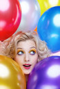 Blonde girl with balloons Royalty Free Stock Image