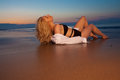 Blonde girl on the beach beautiful dreamy lonely sitting against dusk blue sky more images of this model in my portfolio Royalty Free Stock Images