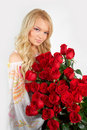 Blonde girl with a bouquet of flowers Stock Images