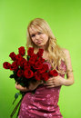 Blonde girl with bouquet roses Royalty Free Stock Image