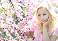 Blonde Girl with Cherry Blossom. Spring Portrait. Beautiful Royalty Free Stock Photo