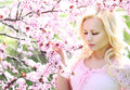 Blonde Girl with Cherry Blossom. Spring Portrait. Royalty Free Stock Photo