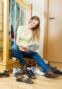 Blonde girl cleaning shoes at home Stock Photography
