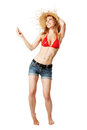 Blonde girl dancing to the music from her mp player isolated on white Royalty Free Stock Image