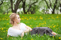 Blonde girl in dandelions Royalty Free Stock Photo
