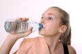Blonde girl drinking water exercise closeup Royalty Free Stock Photo