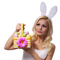 Blonde girl with easter basket isolated on white. Royalty Free Stock Photo