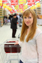 Blonde girl with empty cart Royalty Free Stock Photo