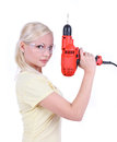 Blonde girl with goggles and drill isalated Stock Photos