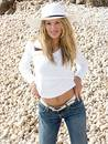 Blonde girl and her tight jeans Royalty Free Stock Photos