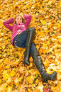 Blonde girl on maple leaves Royalty Free Stock Image