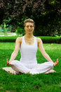 Blonde girl in park doing yoga Royalty Free Stock Photo